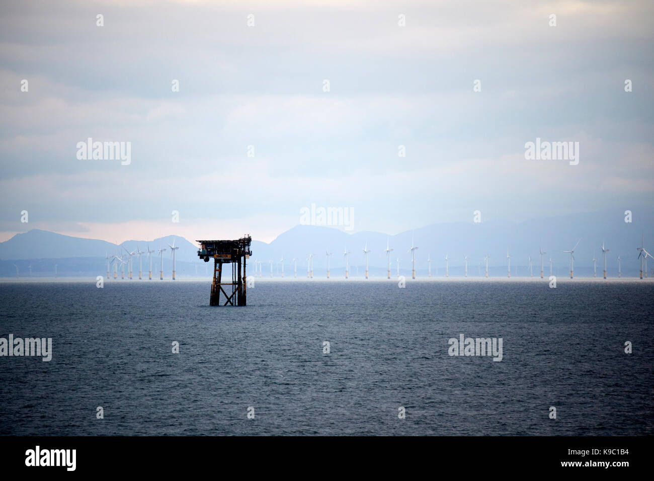 hamilton unmanned satellite platform part of the douglas oil complex in the irish sea in front of north hoyle offshore - Stock Image