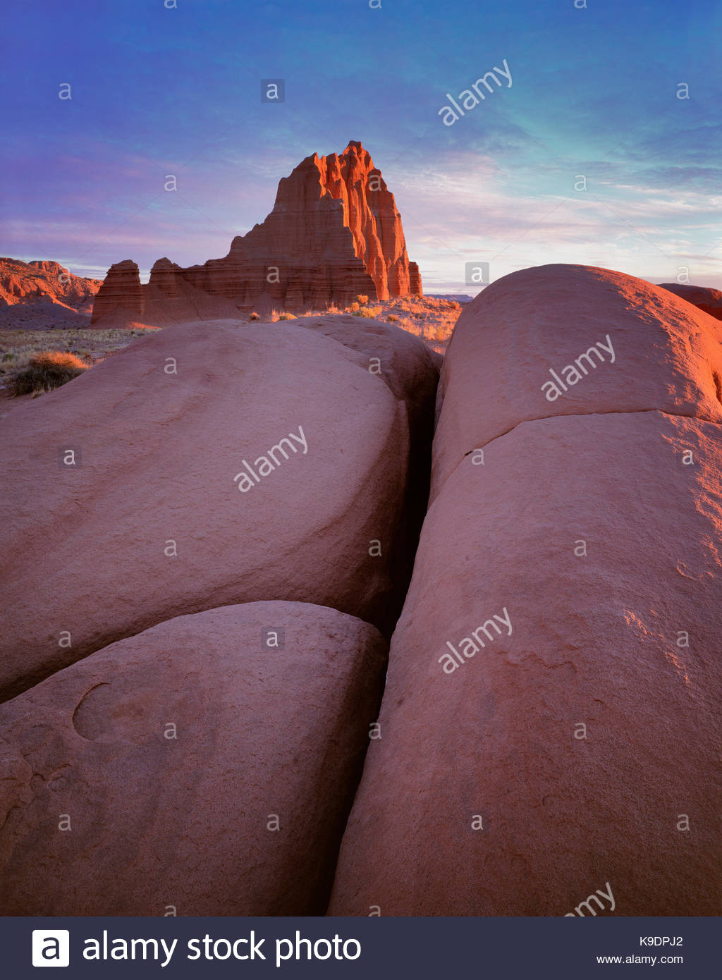 Temple of the Sun at Sunrise, Cathedral Valley, Capitol Reef National Park, Utah - Stock Image