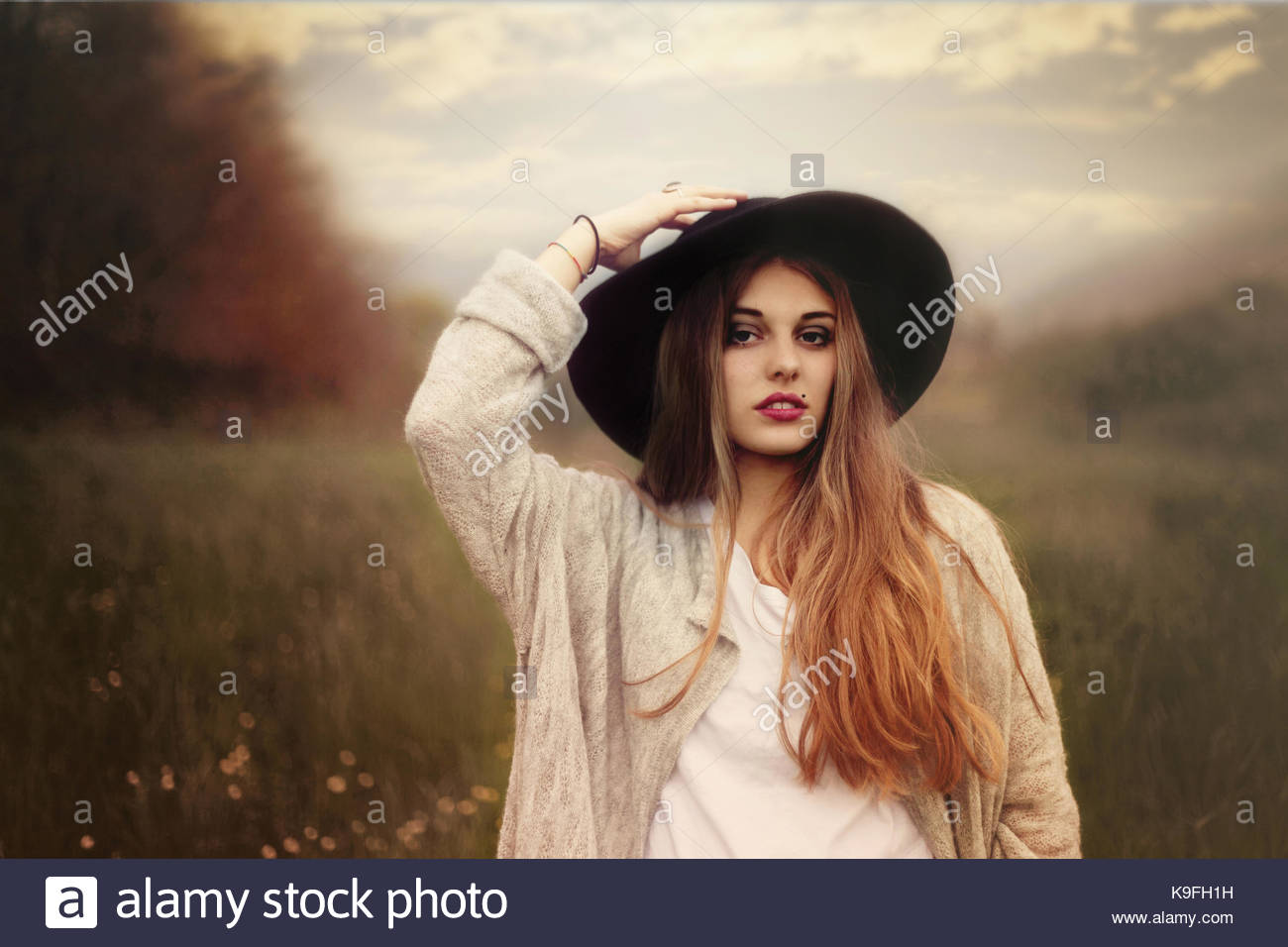 Lady in a field - Stock Image