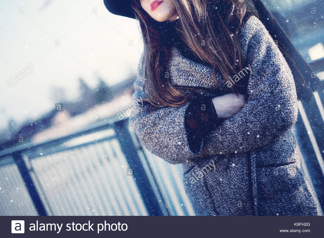 Girl in a snowstorm. Face not showing. - Stock Image