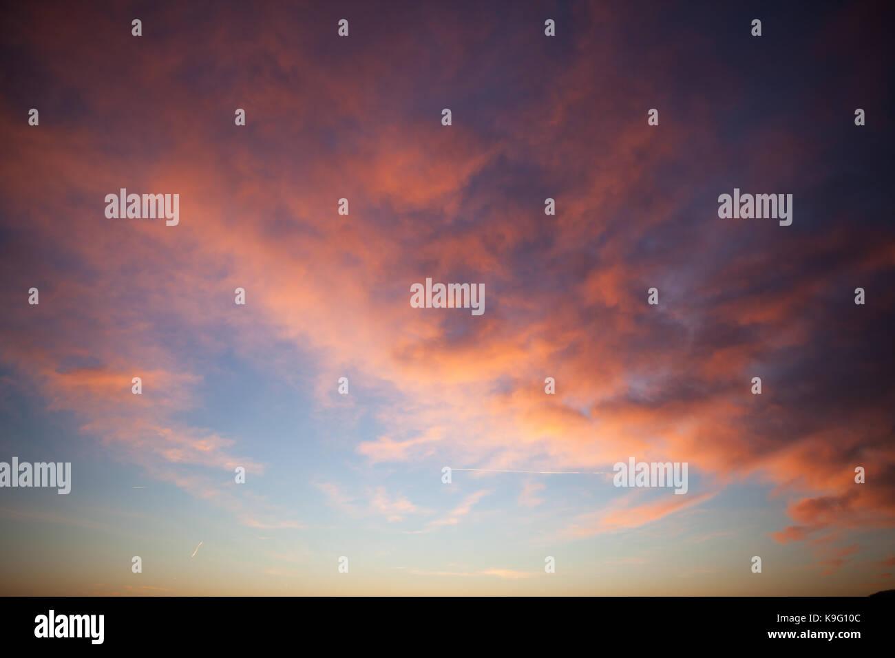 Colorful background: sky overlay, setting sun. - Stock Image