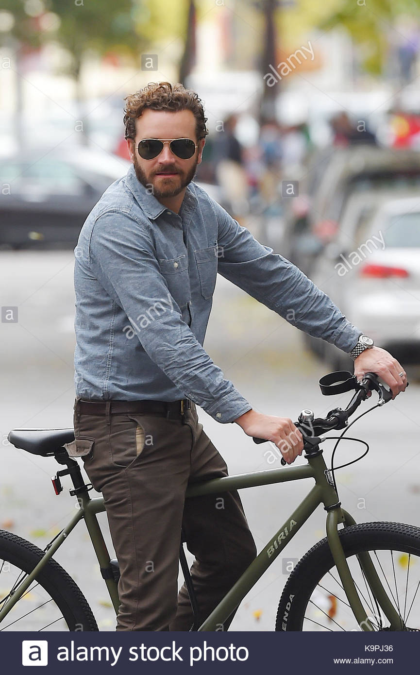 Danny Masterson. Danny Masterson seen out in SoHo on his bike. - Stock Image