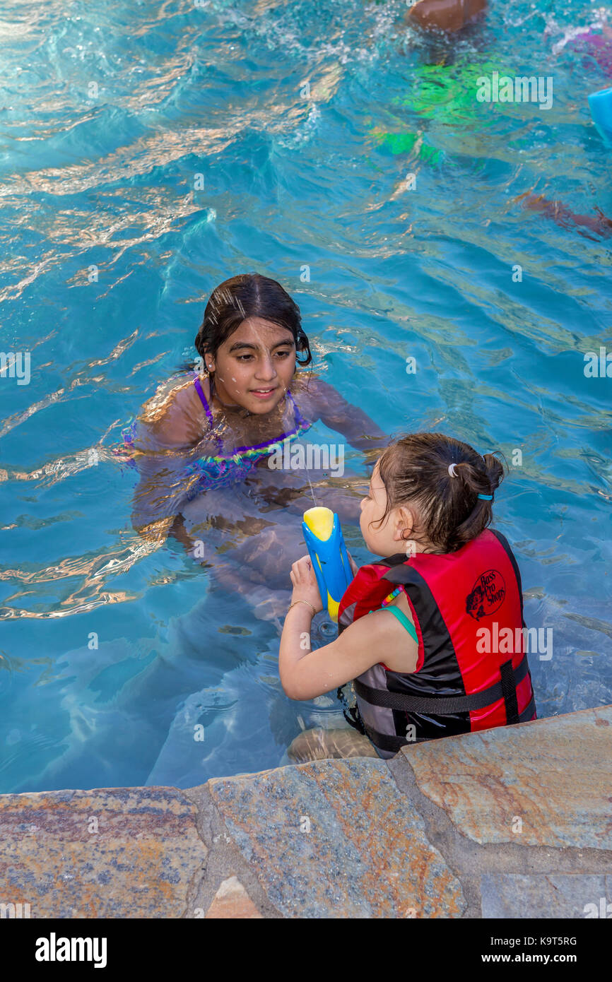 Girls Children Playing Squirting Water Soaker Swimming Pool Stock Photo Royalty Free Image