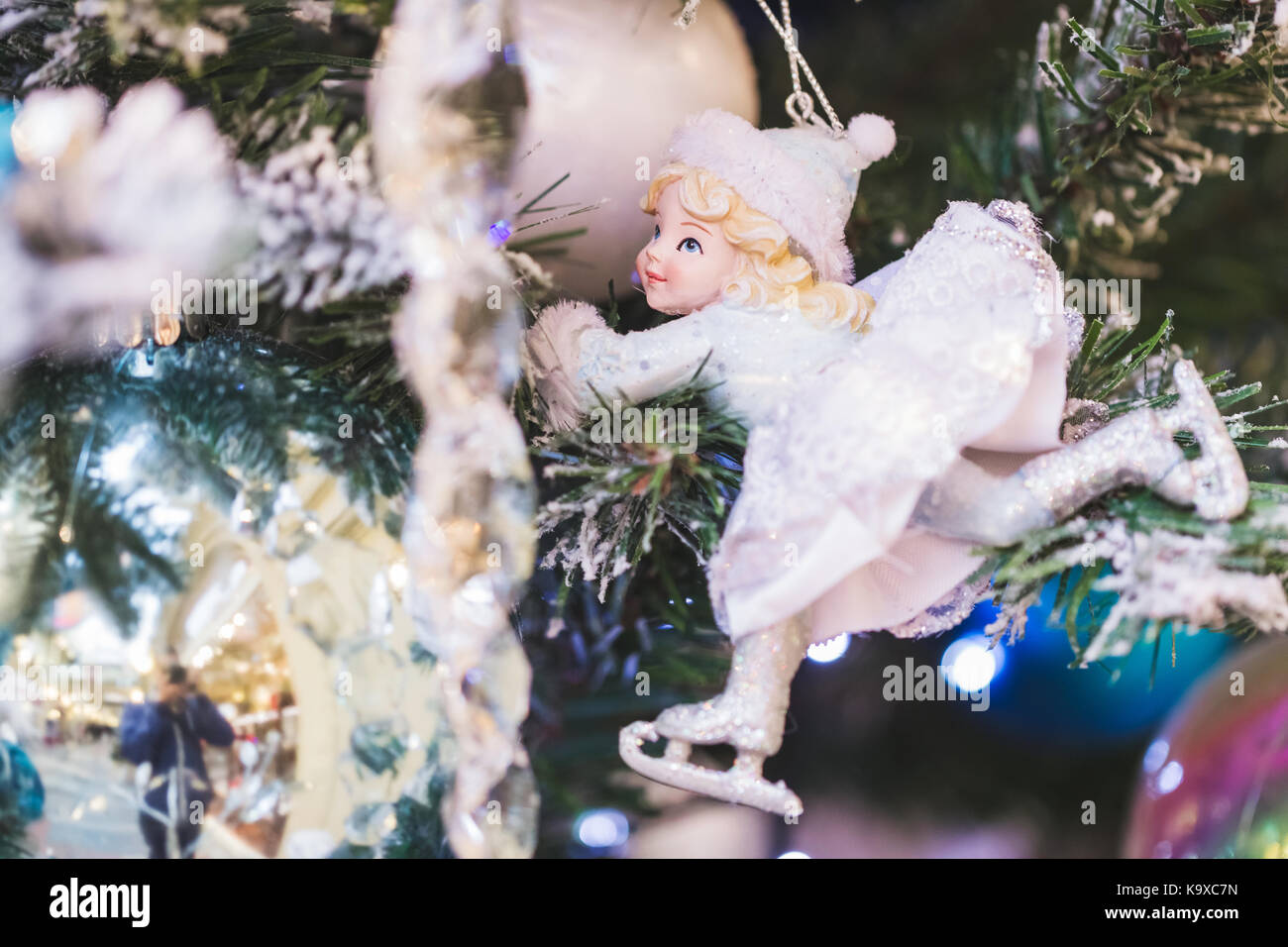 Small toy Snow Maiden in white snow dress as decoration of Christmas tree - Stock Image