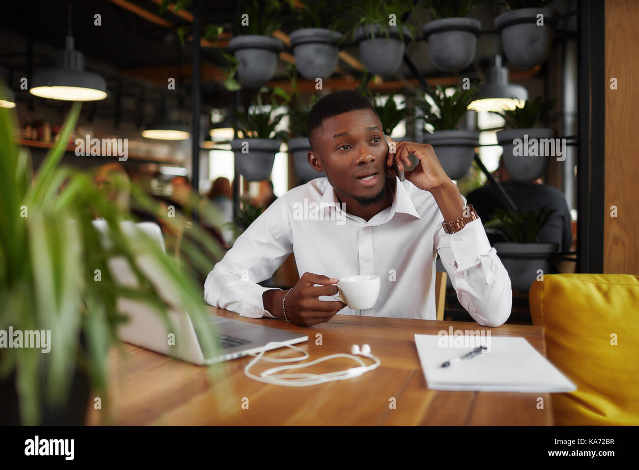 African businessman discussing talking at call phone. - Stock Image