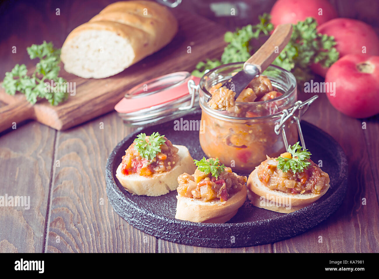 Bread toasts with eggplant caviar. - Stock Image