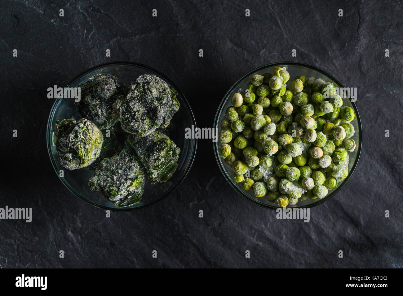 Healthy food frozen spinach and peas top view horizontal - Stock Image