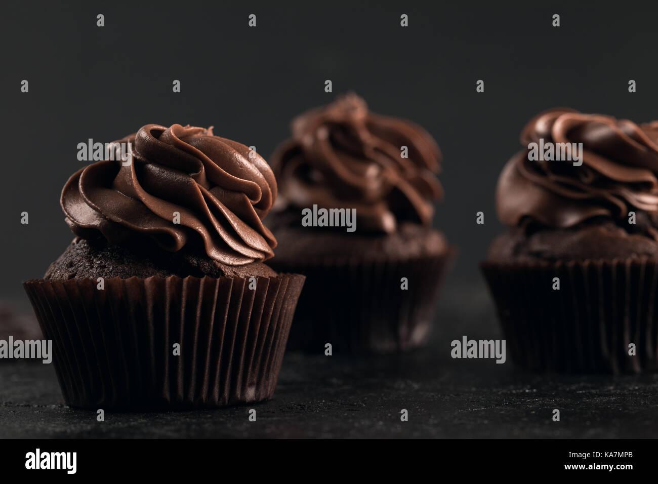 tasty chocolate cupcakes - Stock Image