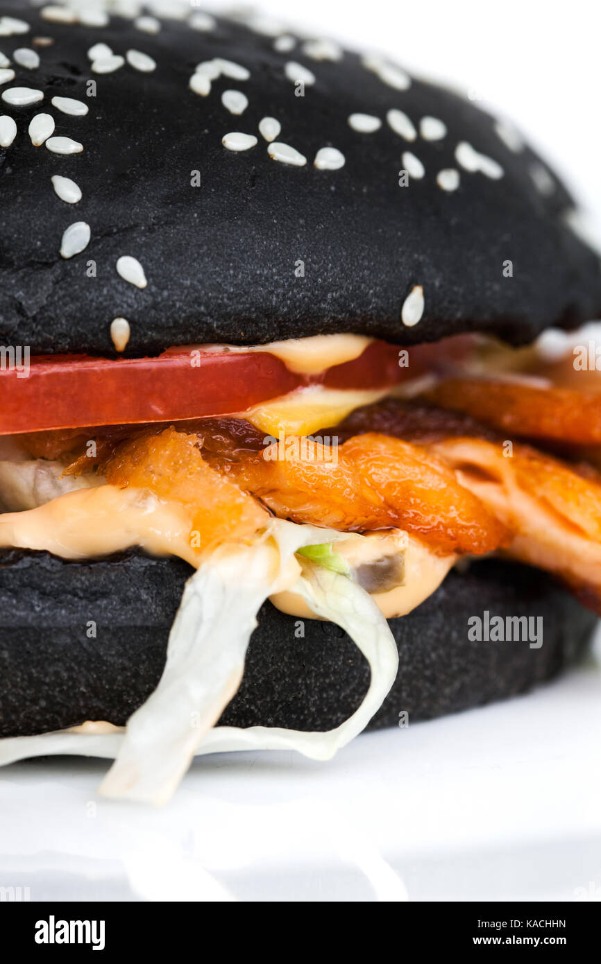 Black burger with salmon - Stock Image