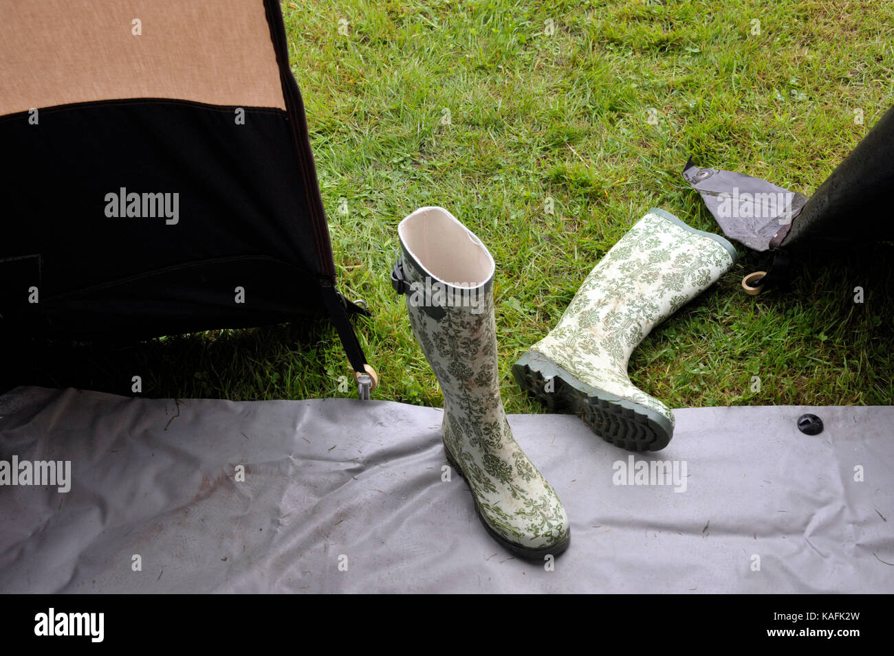 wellington boots in entrance to caravan awning - Stock Image