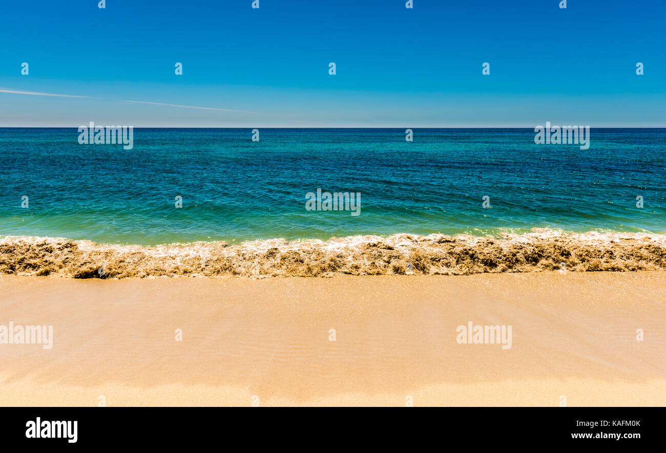 Abstract of three bands of blue sky, azure sea and sandy beach in Brittany, France - Stock Image