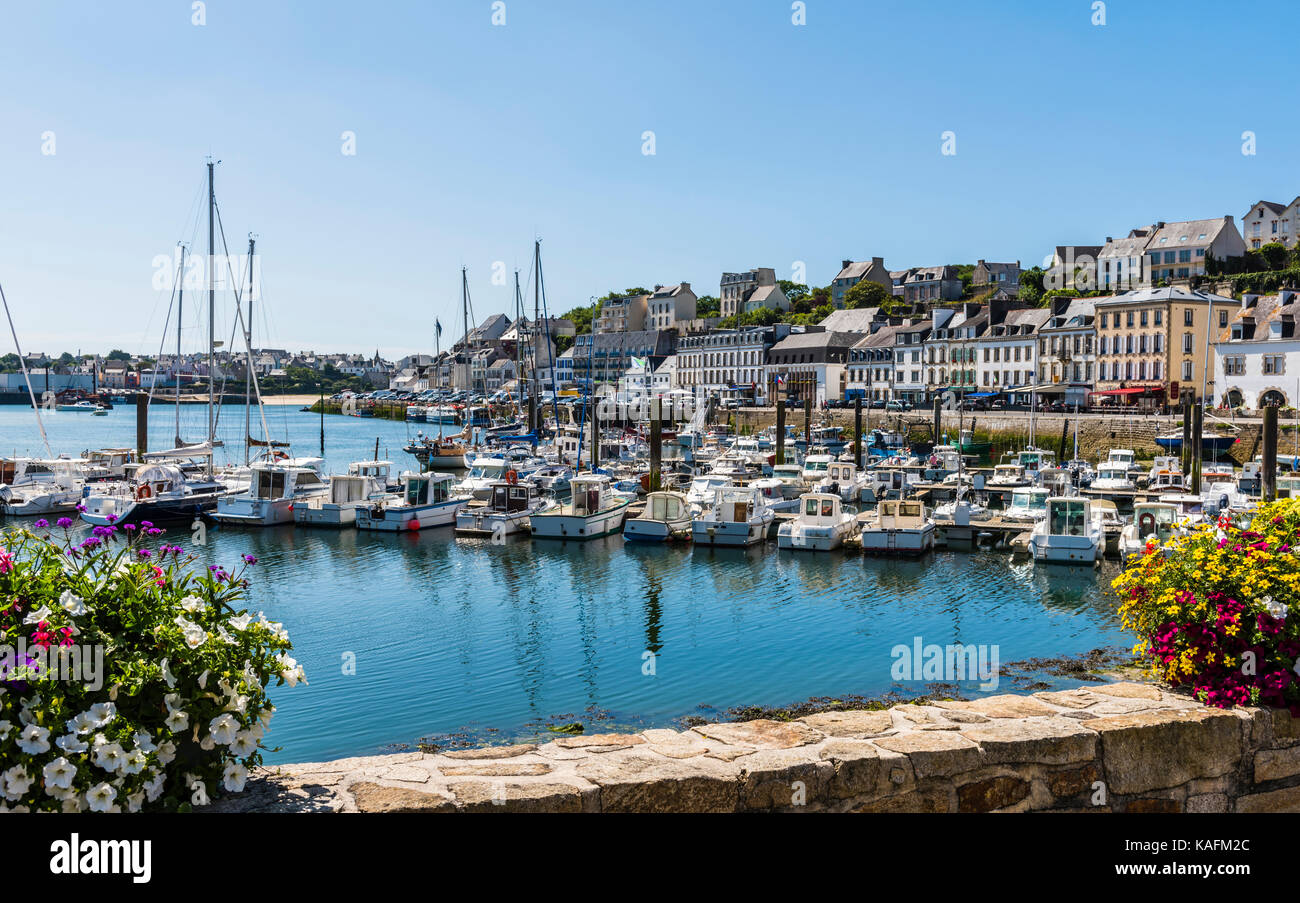 View of the port and summer flowers at Audierne, Brittany, France - Stock Image