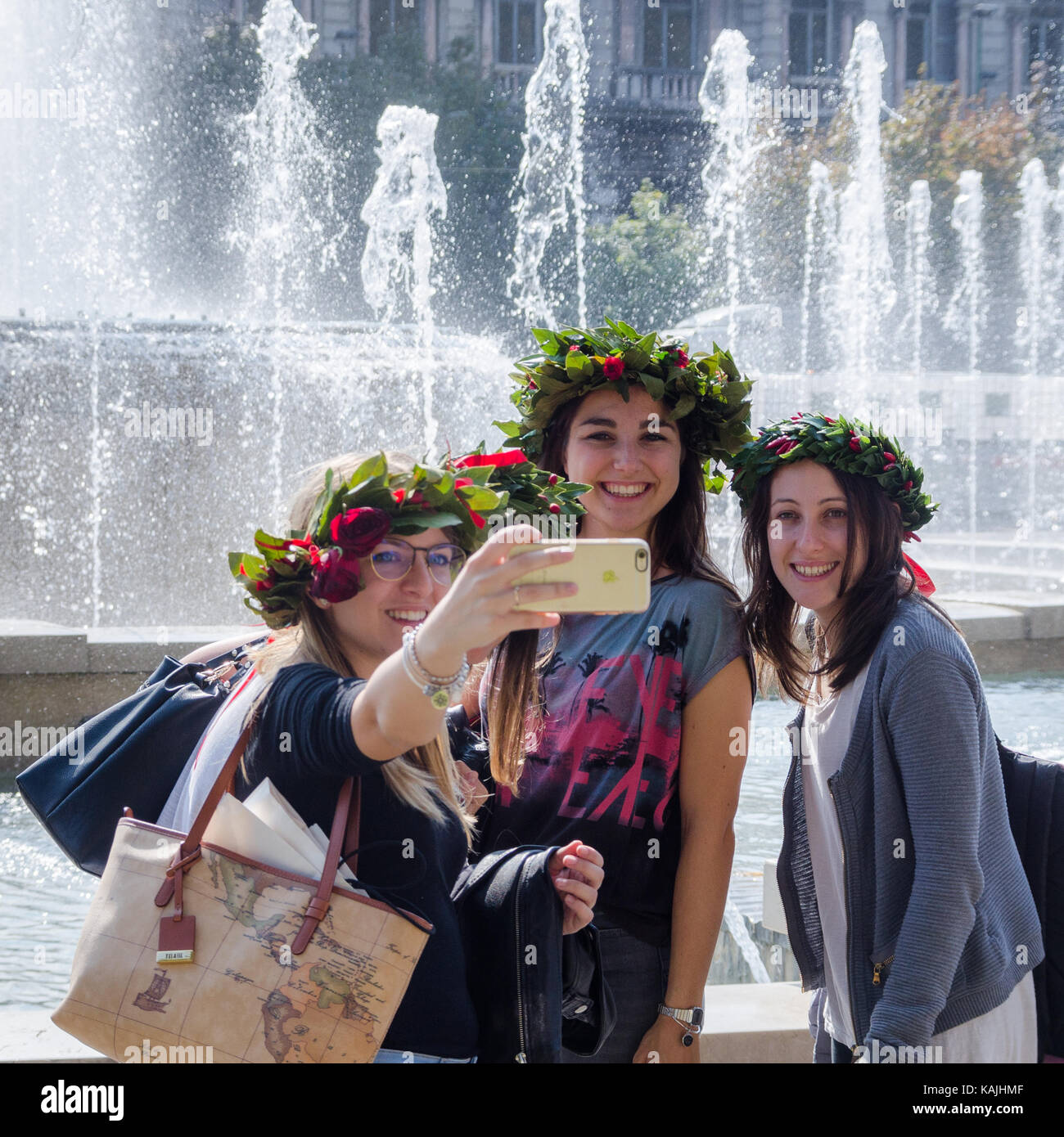 young-women-on-a-hen-party-pose-for-a-selfie-with-an-iphone-in-front-KAJHMF.jpg