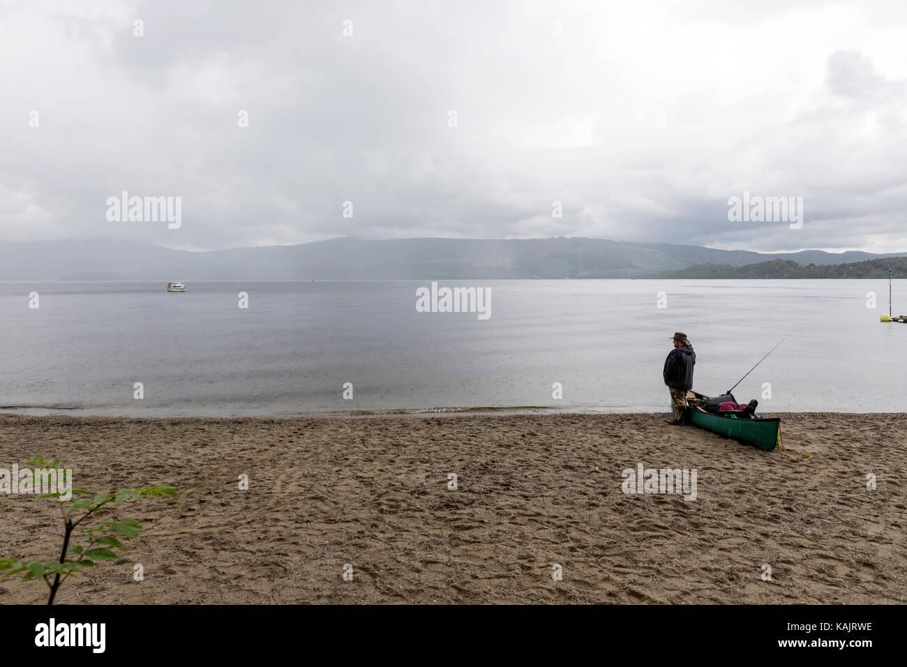 Fishermen fishing uk stock photos fishermen fishing uk for Loch lomond fishing