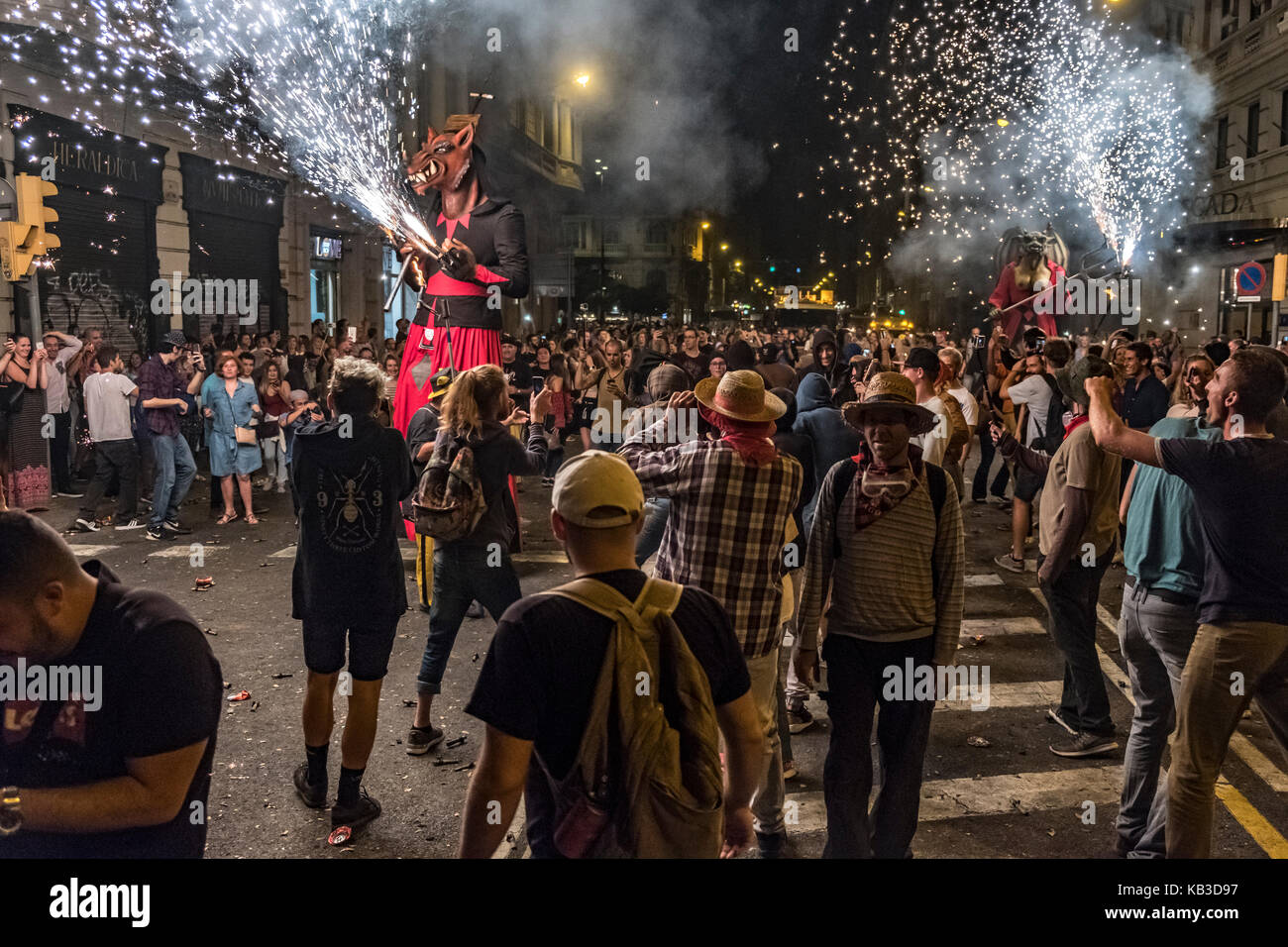 Correfocs are among the most striking features present in Catalan festivals. In the correfoc, a group of individuals Stock Photo