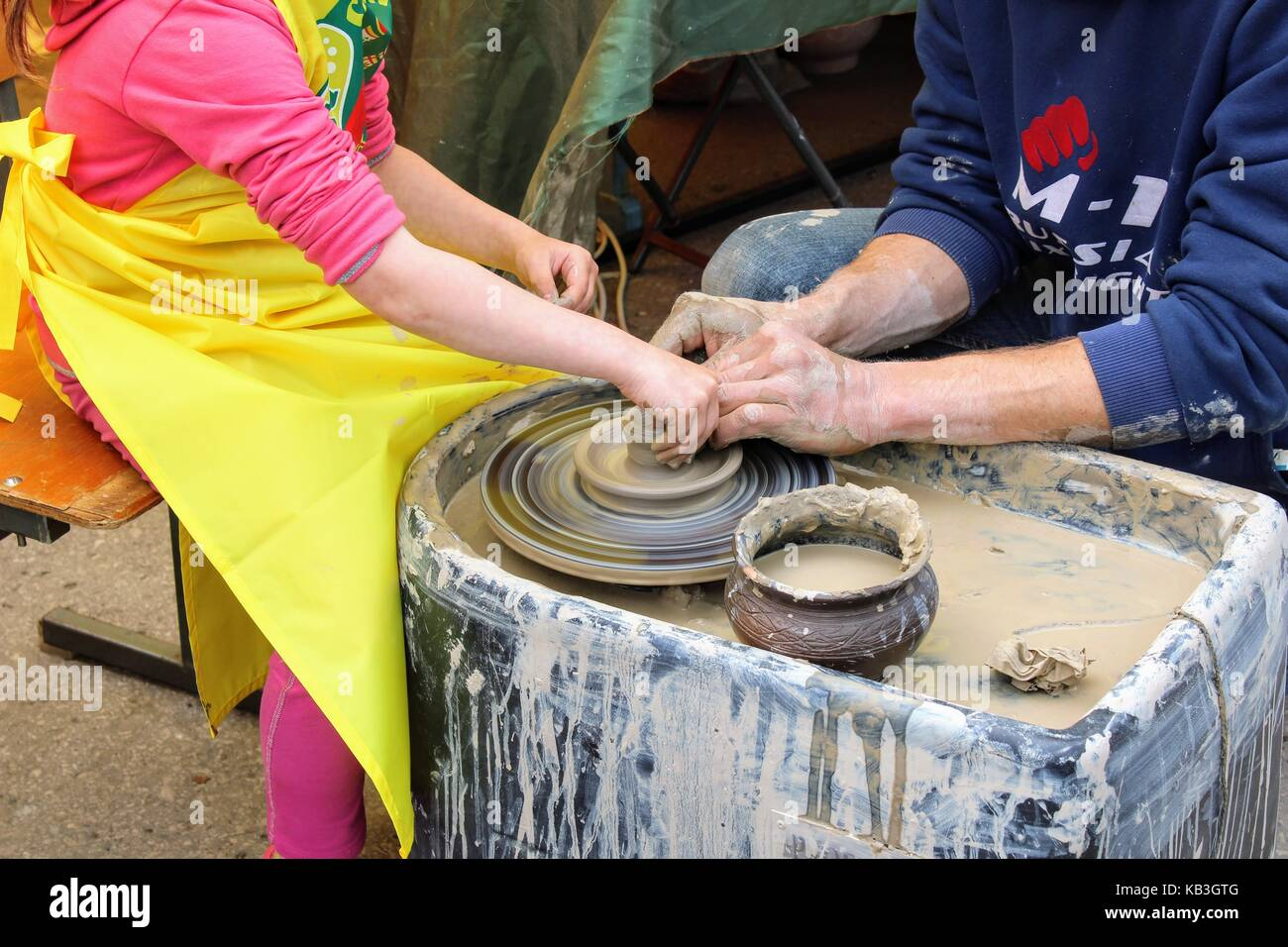 June, 2017, Odoev (Russia): Folk Festival 'Grandfather Filimon's Tales' - master class on making pottery. - Stock Image