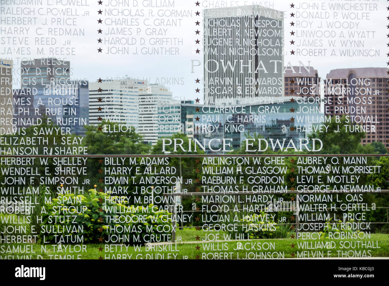 Richmond Virginia Virginia War Memorial Shrine of Memory monument fallen soldiers names glass engraving city skyline - Stock Image