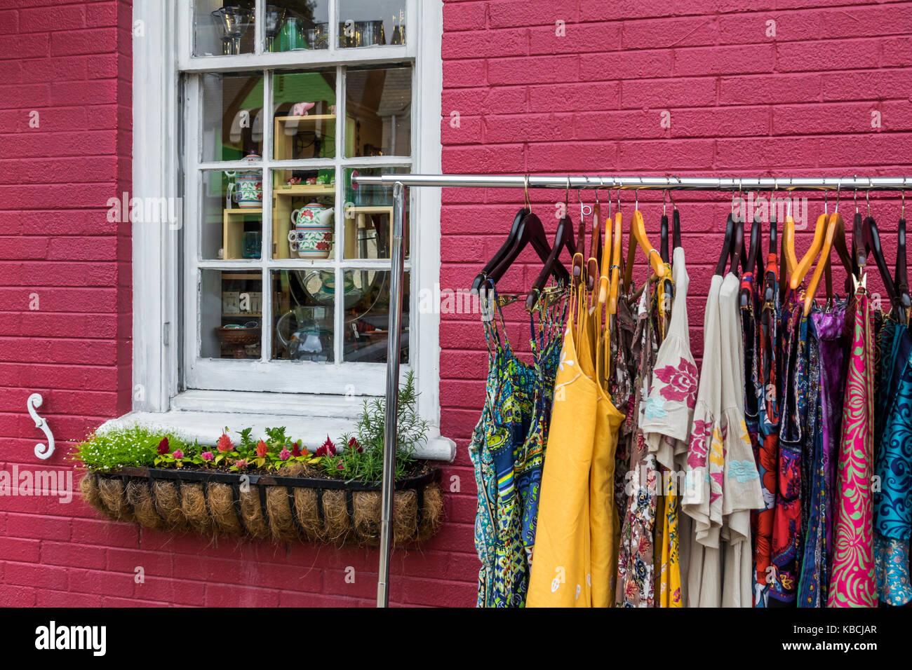 Richmond Virginia Carytown neighborhood urban retail district shopping store clothing rack sidewalk sale AlterNatives - Stock Image
