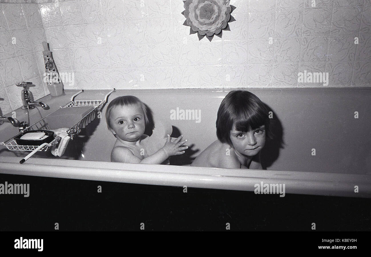 1972, historical, two young children in a bath in a council flat in Baildon Street, Deptford, South London, England, - Stock Image