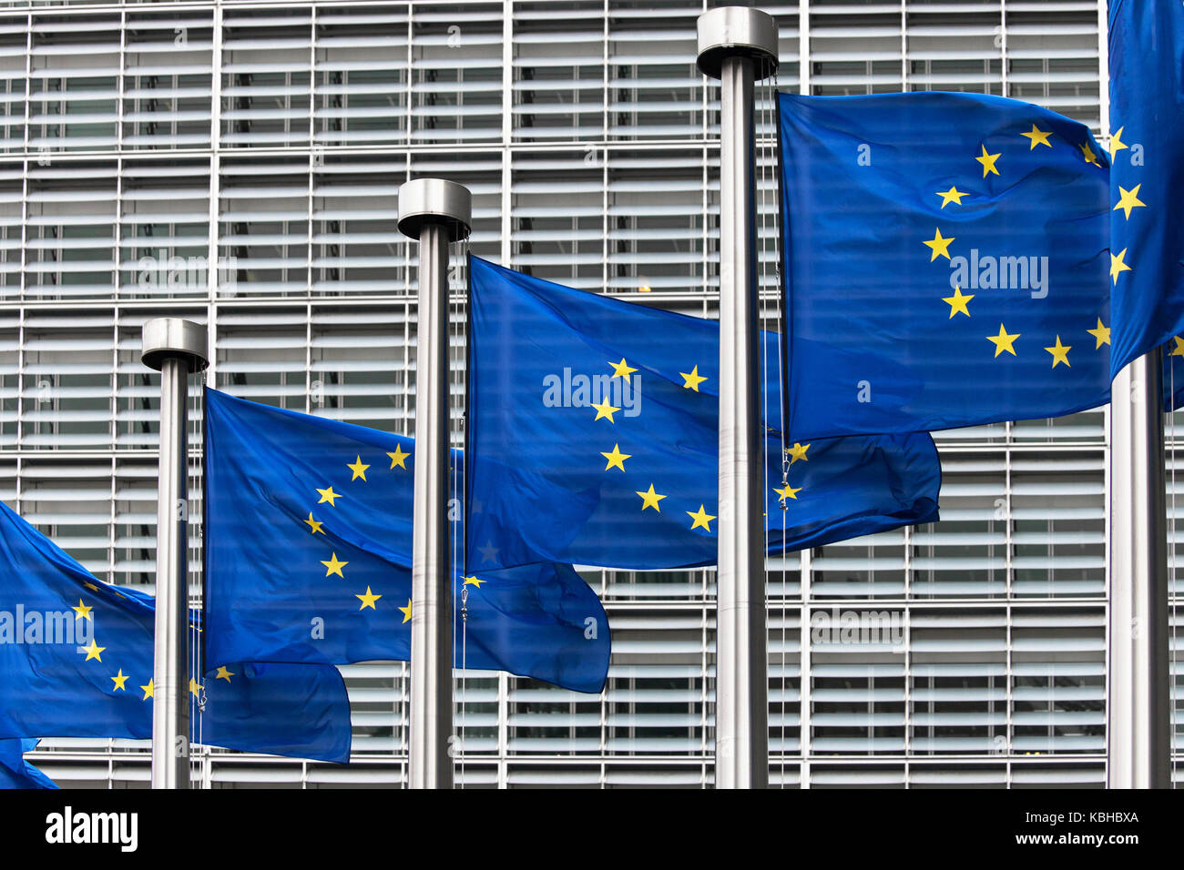 Flags of the European Union in front of the Berlaymont building in Brussels, Belgium. - Stock Image