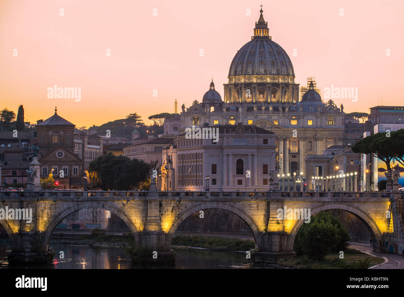Rome, Italy.Vatican dome of Saint Peter Basilica (San Pietro) and Sant'Angelo Bridge, over Tiber river at dusk. - Stock Image