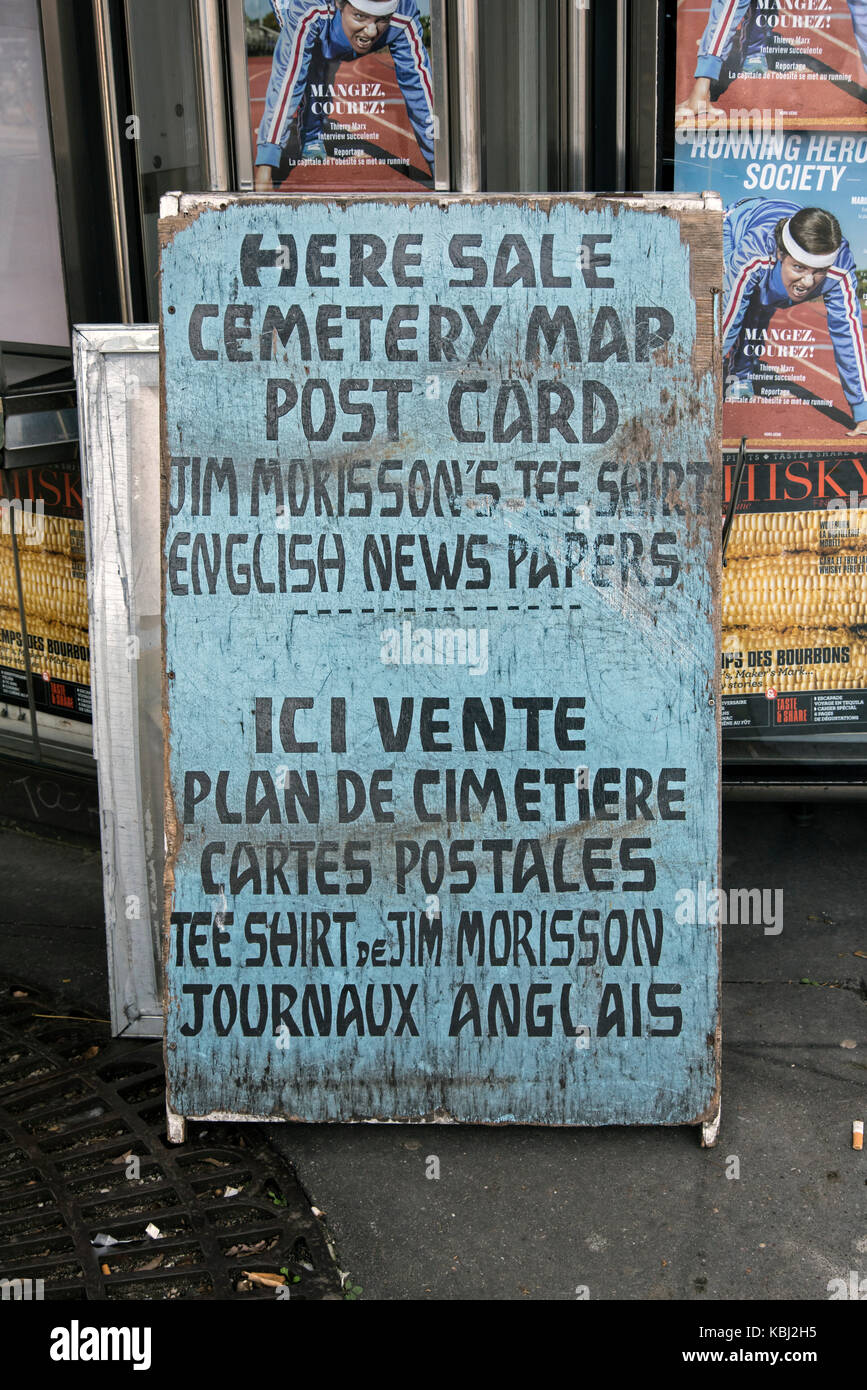 Advertising signs outside Pere Lachaise Cemetery in Paris, France. - Stock Image