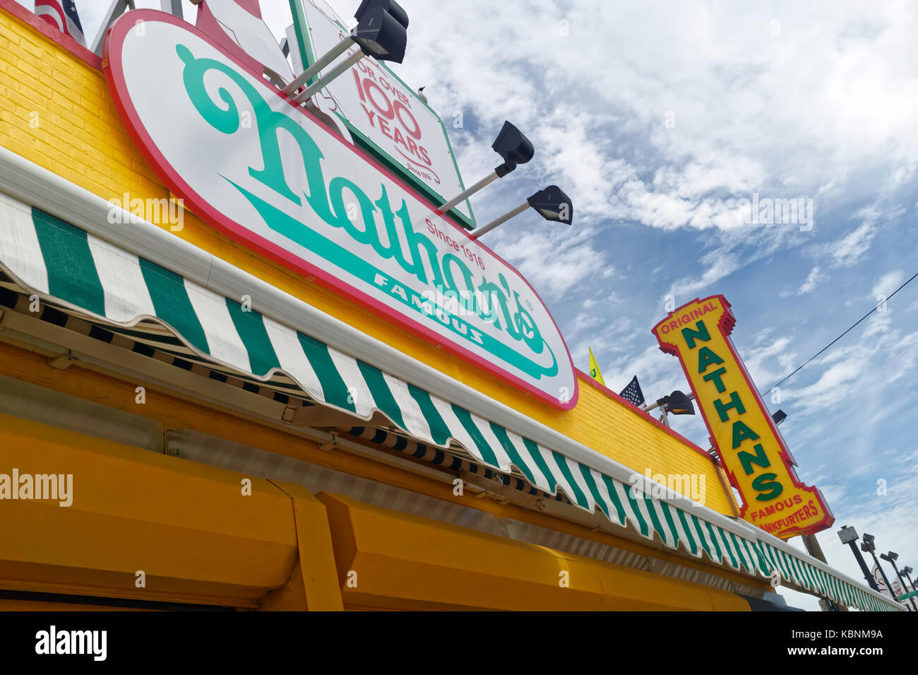 Nathan's Famous hot dog restaurant sign on the Coney Island boardwalk in Brooklyn, New York. - Stock Image