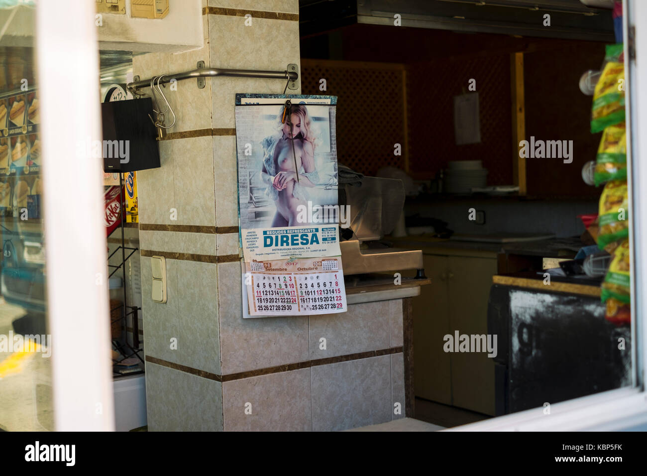 Topless pin-up calendar in a cafe in Lloret de Mar, Spain Stock Photo