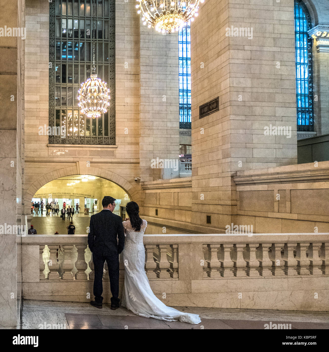 New York, USA,  29 September, 2017.  Newlyweds watch passers-by in New York's Grand Central Station. Photo by - Stock Image