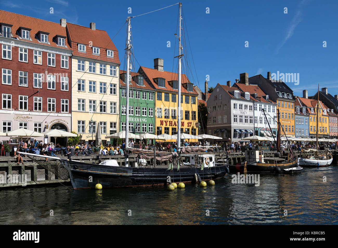 Nyhavn - New Harbor - a 17th-century waterfront, canal and entertainment district in Copenhagen, Denmark. - Stock Image