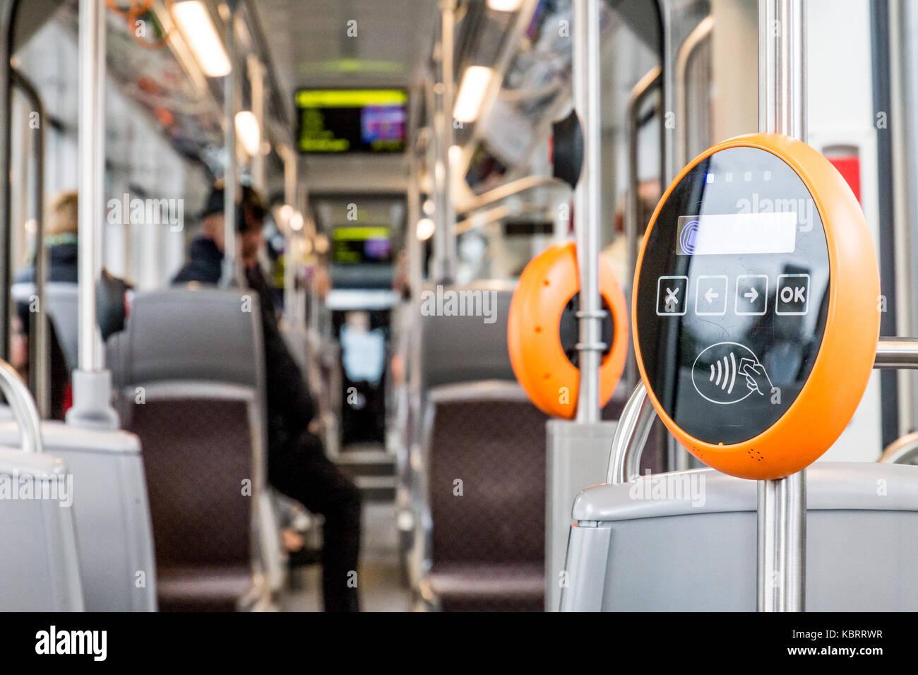 Orange modern magnetic ticket validator - Stock Image