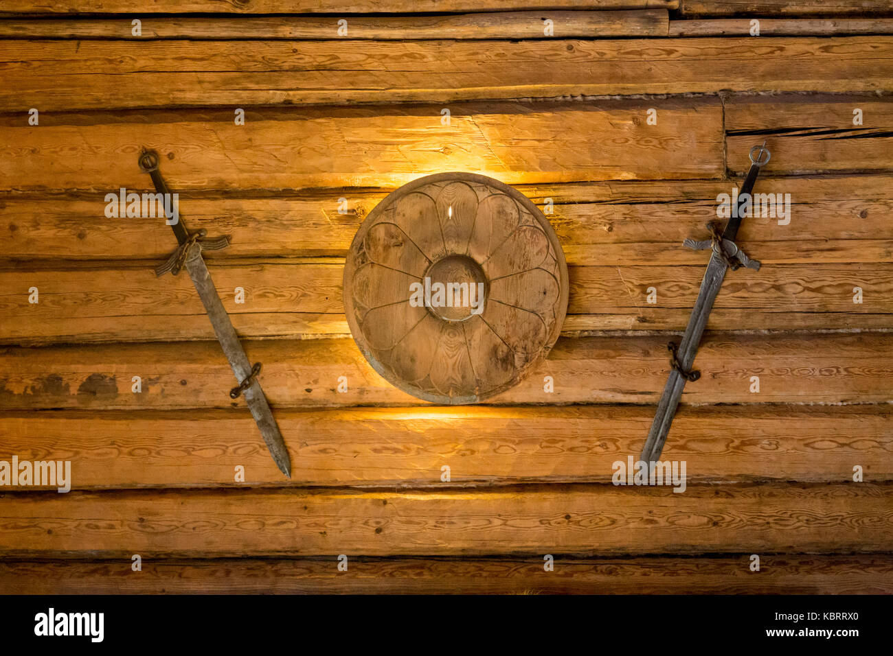 Two medieval sword and shield on wall - Stock Image