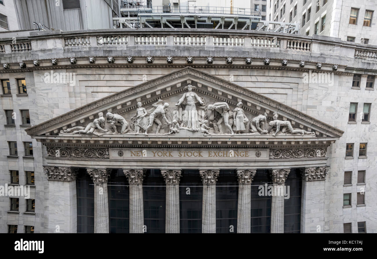 Closeup of the limestone pediment on the facade of the New York Stock Exchange building on Wall Street, sculpted - Stock Image