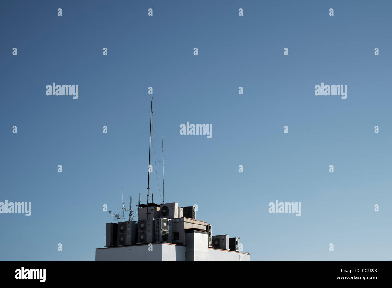 Air conditioning units and aerials above a residential property in Lloret de Mar Stock Photo