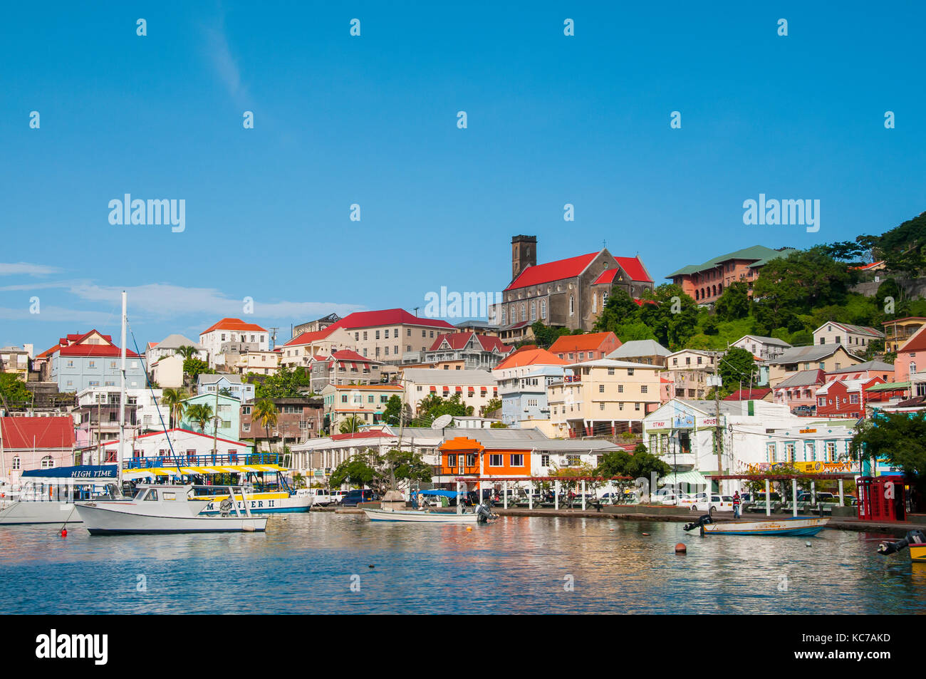 St. George's Grenada is the capital city built on the side of an old vlocano around a horseshoe shaped harbor - Stock Image