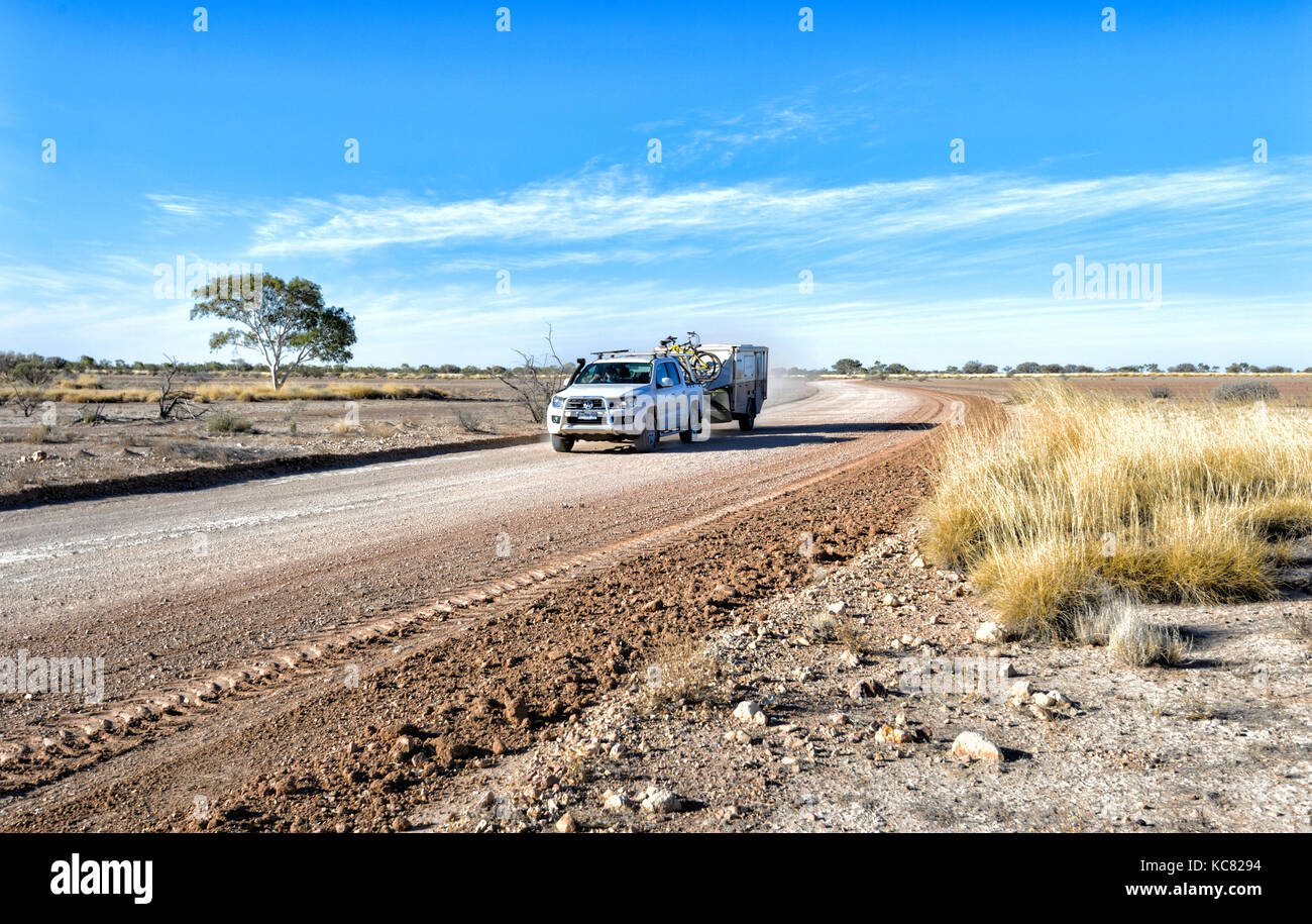 4wd-car-towing-an-off-road-caravan-on-a-