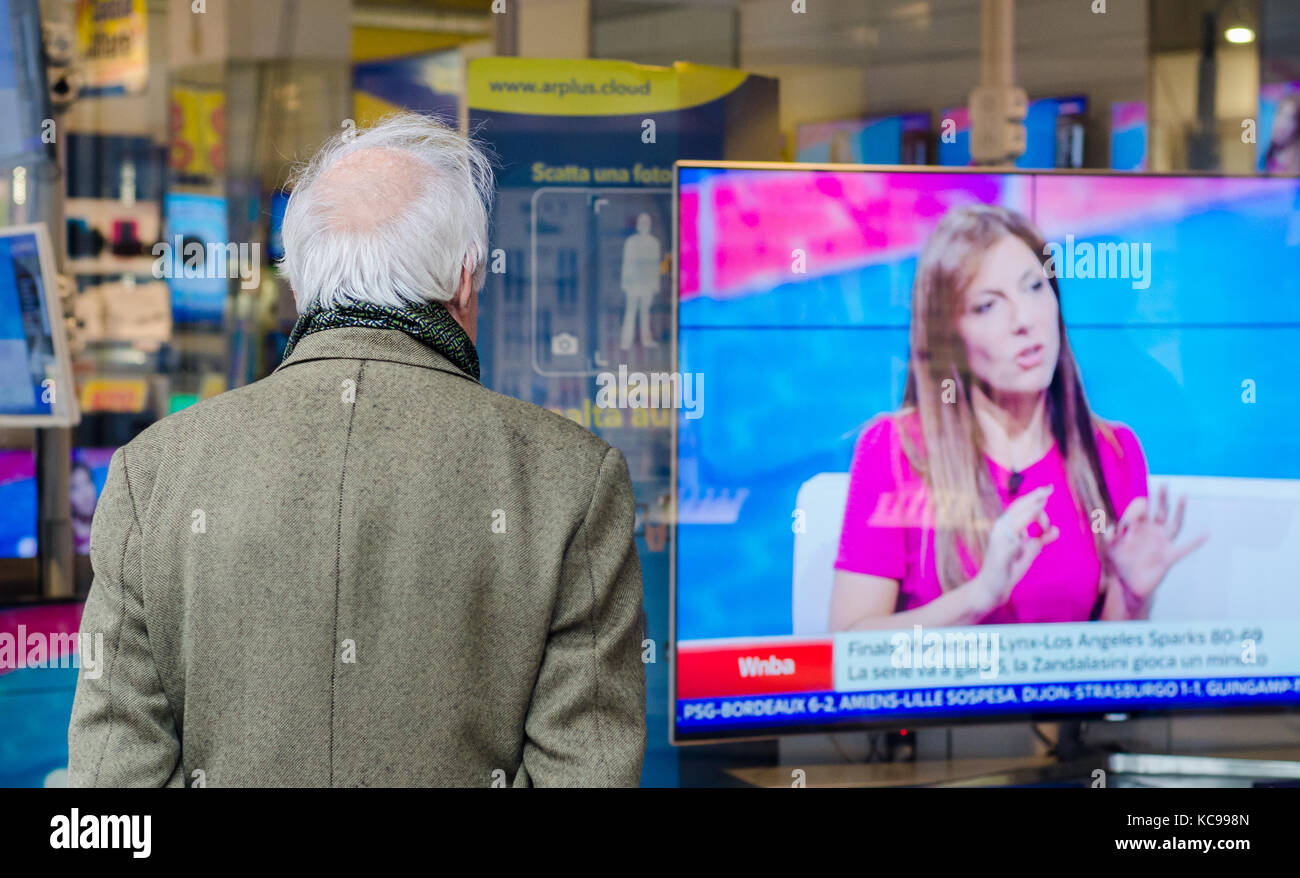 older-bald-man-with-back-turned-looking-at-a-tv-on-display-in-a-shop-KC998N.jpg