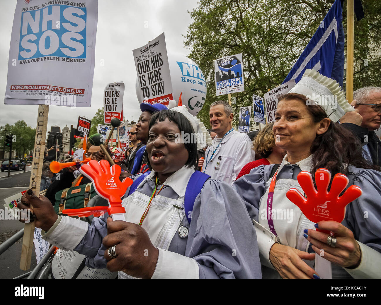 Protesters march and rally over NHS reforms. London, UK. - Stock Image