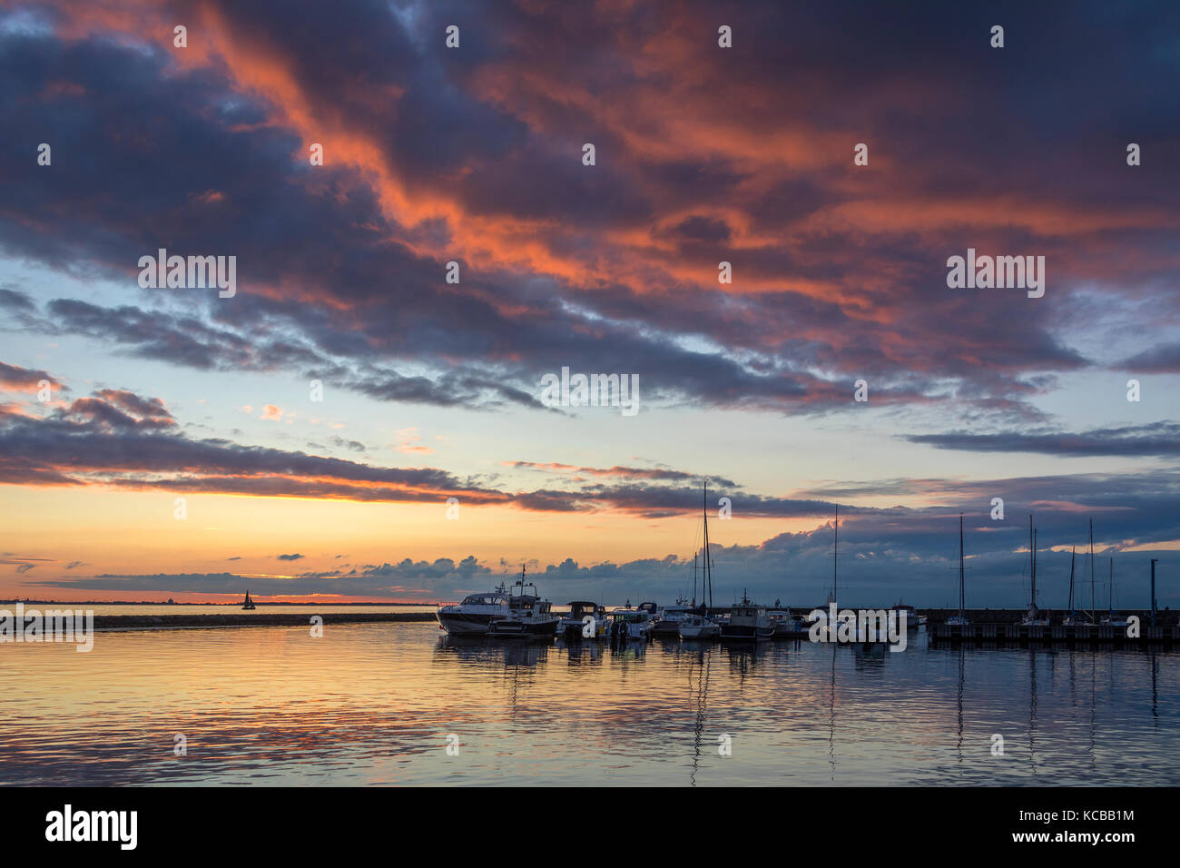 Sunset at Pirita Marina, Tallinn in Estonia. Pirita is one of the most prestigious and wealthiest districts of Tallinn, - Stock Image
