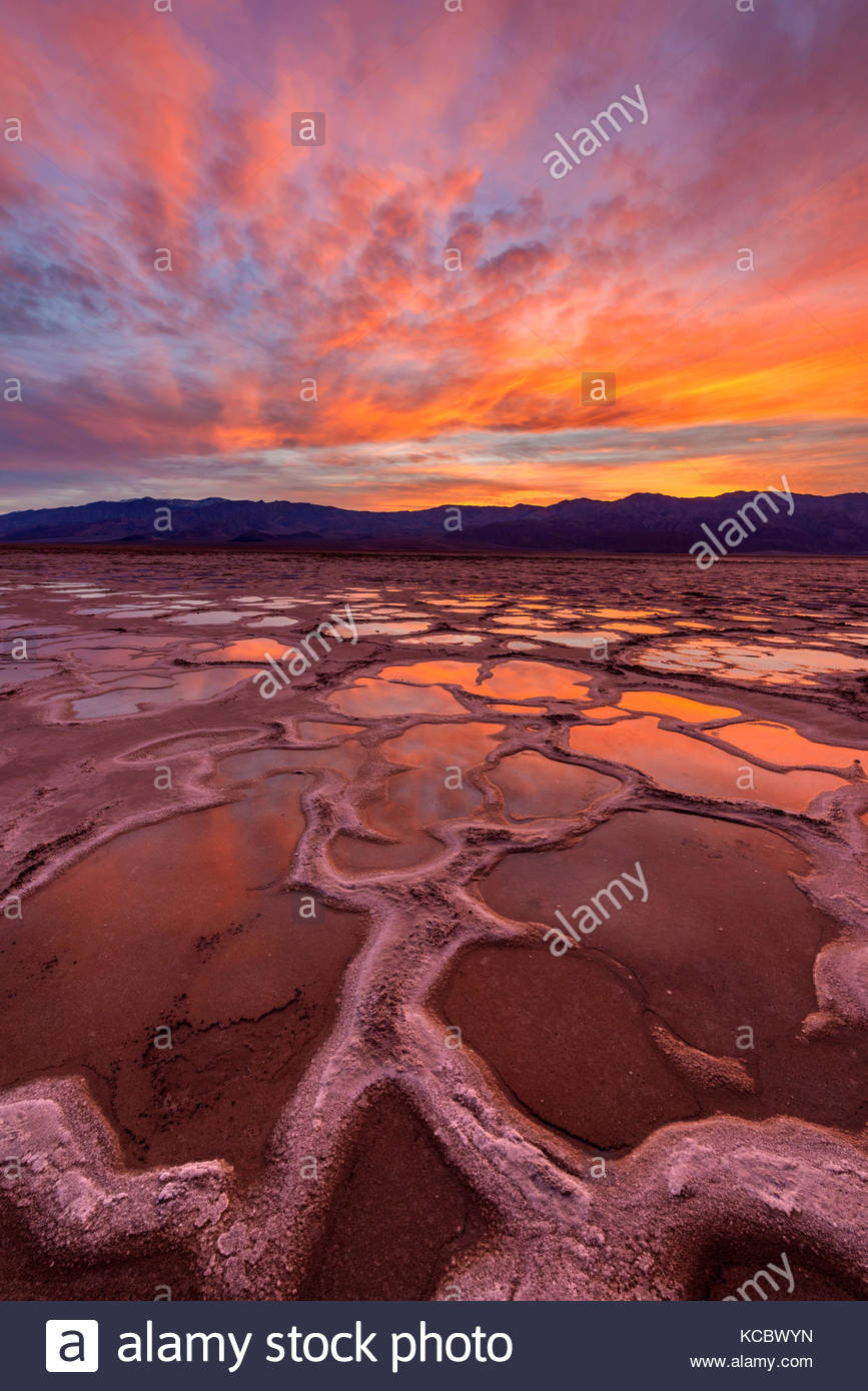 Playa after Rain as Sun Sets over the Panamint Range, Death Valley National Park, California - Stock Image