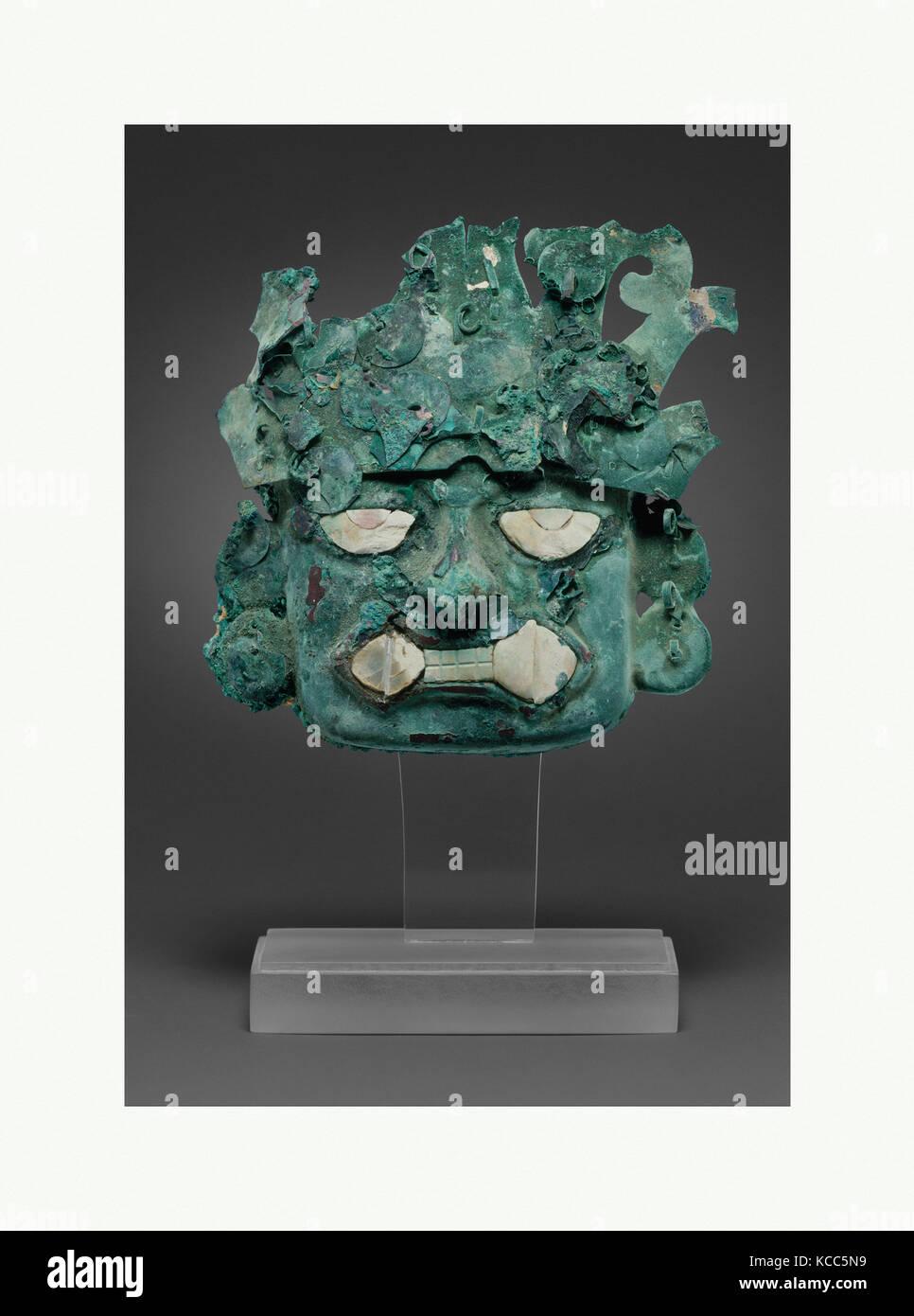 Ornamental mask, 390–450, Peru, Moche (Loma Negra), Silvered copper, shell, H. 3 3/4 x W. 3 15/16 in. (9.5 x 10 - Stock Image