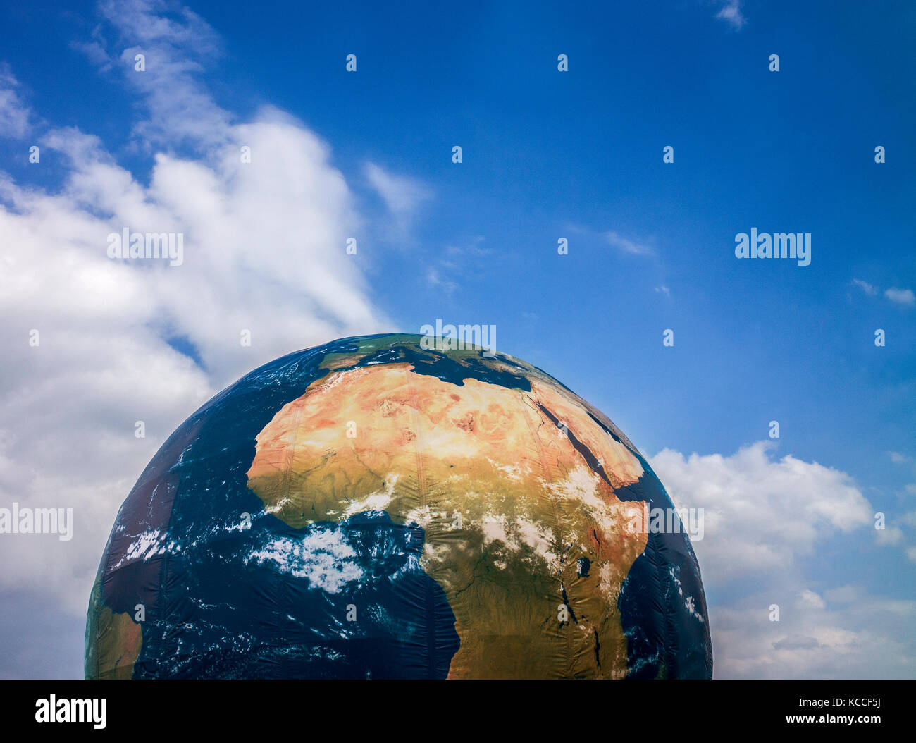 inflatable globe ,climate change installation in docks at Aarhus denmark - Stock Image