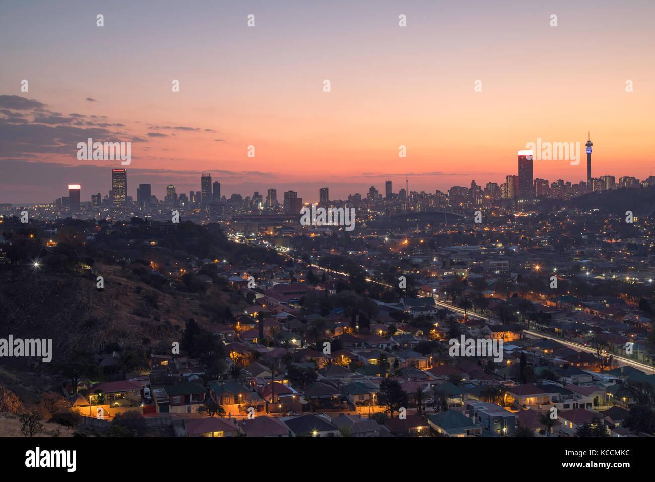 View of skyline at sunset, Johannesburg, Gauteng, South Africa - Stock Image