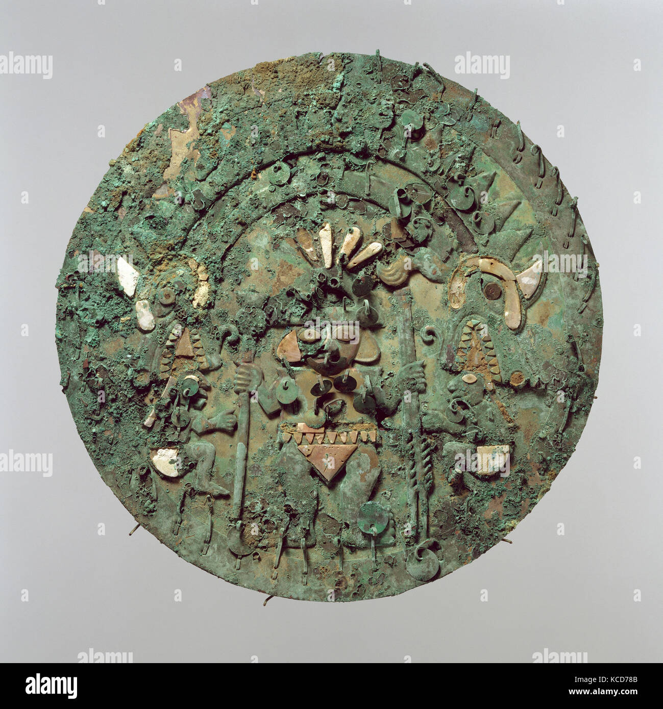 Disk with Figure, 2nd–3rd century, Peru, Moche, Gilded copper, silvered copper, shell, turquoise, Diam. 11 1/8 in. - Stock Image