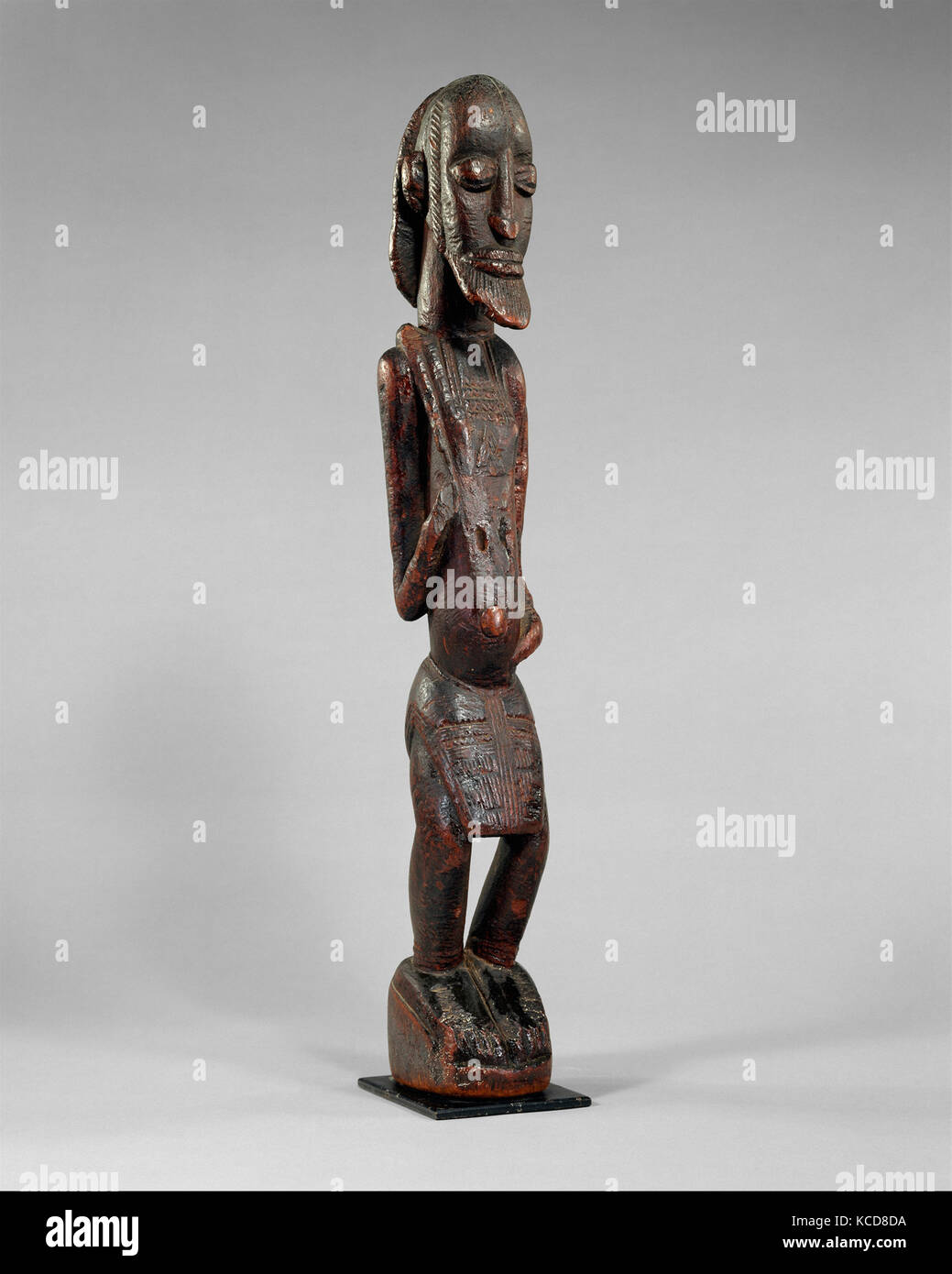 Figure: Male, 12th–17th century (?), Mali, Dogon peoples (?), Wood, H. 25 3/8 x W. 3 7/8 x D. 4 5/8 in. (64.5 x - Stock Image