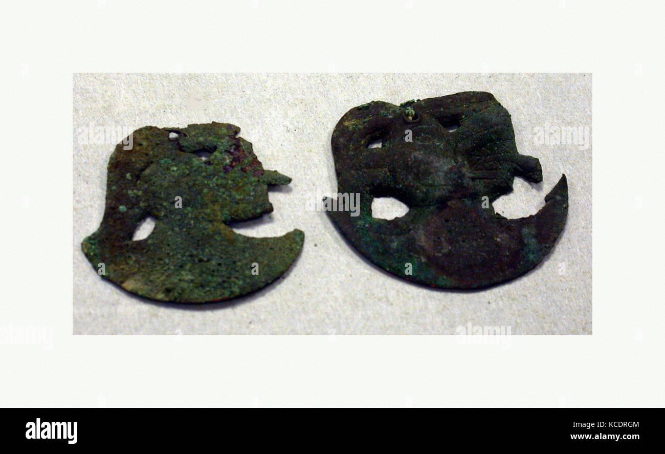 Crescent Ornaments, 390–450, Peru, Moche (Loma Negra), Copper, H. 2 x W. 1 3/8 in. (5.1 x 3.5 cm), Metal-Ornaments - Stock Image