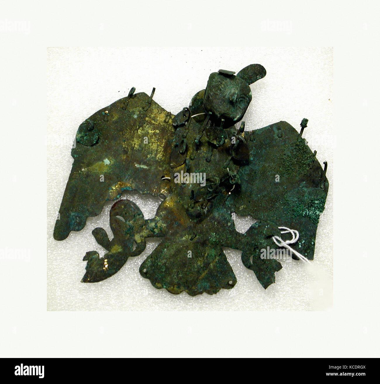 Owl Ornament, 390–450, Peru, Moche (Loma Negra), Gilded copper, H. 4 7/8 x W. 5 1/4 x D. 7/8 in. (12.5 x 13.3 x - Stock Image