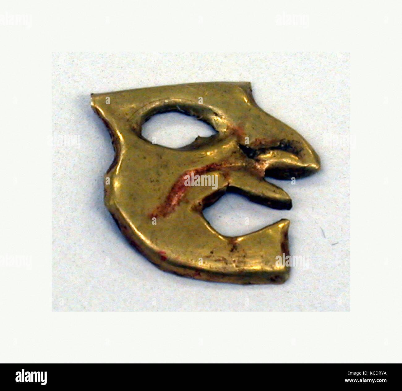 Gold Face Mask Ornament, 390–450, Peru, Moche (Loma Negra), Gold, Height 23/32 in., Metal-Ornaments - Stock Image