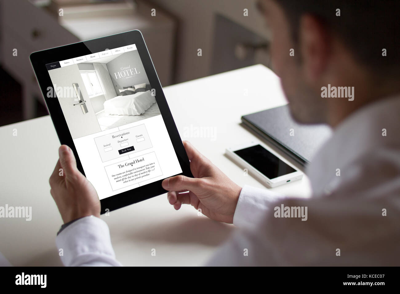 Bussinessman stock photos bussinessman stock images alamy for Tablet hotel booking