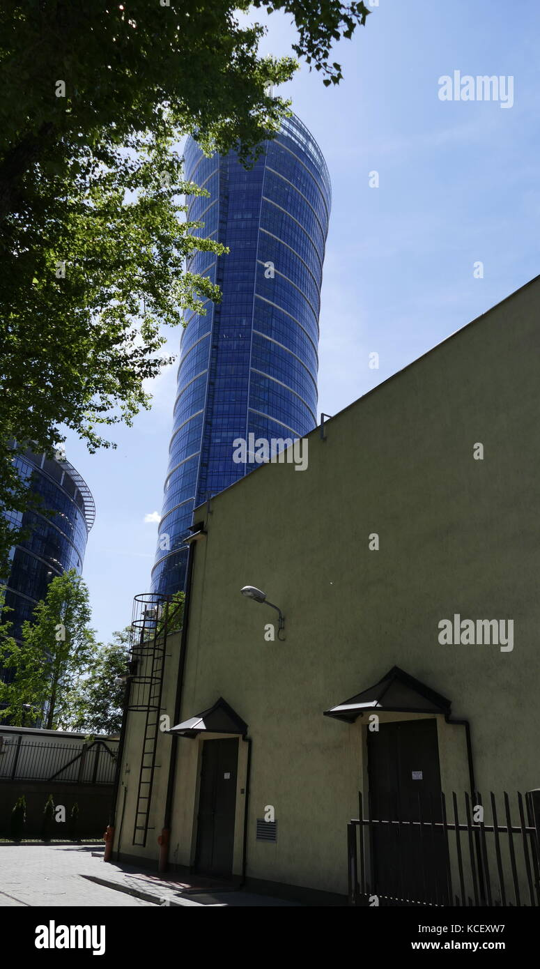 Photograph of the Warsaw Spire is a complex of Neomodern office buildings in Warsaw, Poland constructed by the Belgian - Stock Image